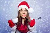 Santa girl enjoying coffee in winter — Stock Photo