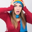 Surprised woman in colorful winter clothes — Stock Photo #38211735