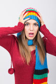 Surprised woman in colorful winter clothes — Stock Photo