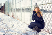 Cute blonde teenage girl outdoors in park in winter — Stock Photo