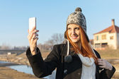Cute redhead young woman taking a selfie — Stock Photo