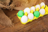 Beautiful Easter eggs in yellow carton — Stock Photo