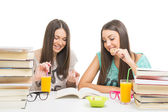 Teenage girls eating while learning together — Stock fotografie