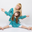 Mother and daughter in matching outfit having fun — Stock Photo #45614319