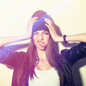 Hipster girl with beanie holding head making funny face — Stock Photo