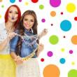Two trendy young women with colorful necklaces — Stock Photo #49020951