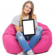 Cute teenage student girl showing tablet with white screen — Stock Photo #49861265