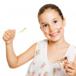 Cute messy little girl eating sweets — Stock Photo #51543257
