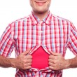 View of happy smiling hipster boy tearing off his shirt on white background — Stock Photo #14625089