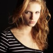 Portrait of a fashionable ginger model in t-shirt with black and — 图库照片