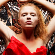 Arty portrait of a fashionable red-haired model in red with hand — Stock Photo #14625231