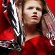 Stock Photo: Arty portrait of fashionable red-haired model in red with silv
