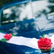 Vintage Wedding Car Decorated with Flowers. Outdoor shot - Stock Photo