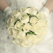 Wedding bouquet at bride's hands. studio shot — Stock Photo