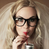 Portrait of a funny beautiful hipster bride drinking something f — Stock Photo
