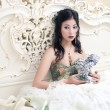 Vintage portrait of a beautiful queen like girl in the white bed — Stock Photo #16209809