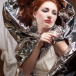 Stock Photo: Arty portrait of fashionable queen-like model with silver foil