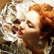Stock Photo: Arty portrait of fashionable queen-like ginger model with silv