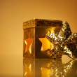 Golden glamour theme with sparkling christmas star and handmade - Stock Photo