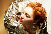 Arty portrait of a fashionable queen-like ginger model with silv — Stock Photo