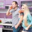 Portrait of a cute young couple preparing drinking fresh citrus — Stock Photo #17387863