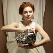 Arty portrait of a fashionable queen-like ginger model holding s — Stock Photo