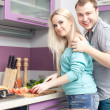 Portrait of a modern romantic couple preparing a meal. Woman is — Stock Photo