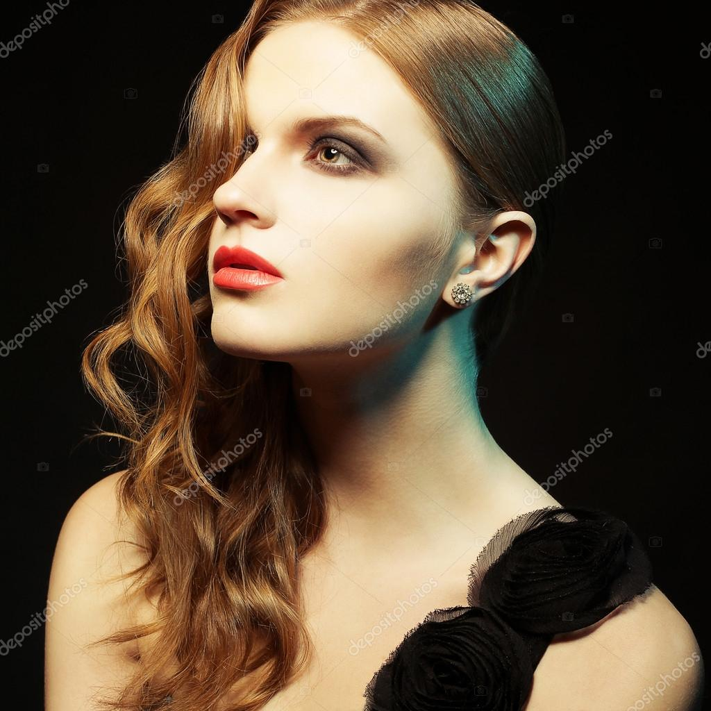 Glamorous ginger girl with perfect makeup posing in black dress over black background. studio shot — Stock Photo #17419463