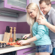 Portrait of a modern romantic couple preparing a meal. Woman is — Stock Photo #17683519