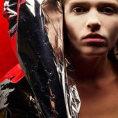 Arty portrait of a fashionable red-haired model with silver foil — Stock Photo