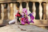 A beautiful wedding bouquet of irises, roses, freesia and tulips — Stock Photo