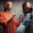 Portrait of two gorgeous girlfriends in blue and orange dresses — ストック写真