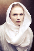 Emotive portrait of a beautiful virgin in white. Studio shot — 图库照片
