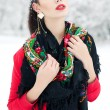 Winter girl in red cardigan with russian kerchief and luxury fas - Stock Photo