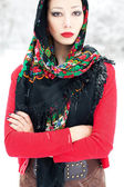 Winter girl in red cardigan with russian kerchief and luxury fas — Stock Photo