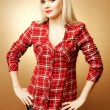 Pin-up portrait of a beautiful housewife in casual clothes posin — Stock Photo