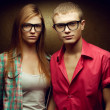Portrait of gorgeous red-haired fashion twins in casual shirts w — Stock Photo