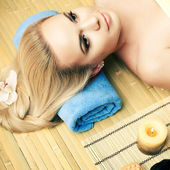 Portrait of a beautiful young woman at a spa salon with white or — Stock Photo