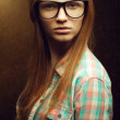 Portrait of a young beautiful red-haired wearing trendy glasses — Stock Photo #20993673