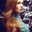 Portrait of a beautiful ginger (red-haired) girl in blue orient — Stok fotoğraf