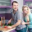 Stock Photo: Portrait of a modern romantic couple preparing a meal (vegetable