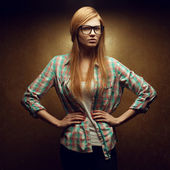 Portrait of a young beautiful red-haired wearing trendy glasses — Stok fotoğraf