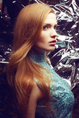 Portrait of a beautiful ginger (red-haired) girl in blue orient — Stock Photo