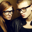 Foto Stock: Portrait of gorgeous red-haired fashion twins in black clothes w