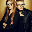 Portrait of gorgeous red-haired fashion twins in black clothes w — Stockfoto