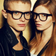 Portrait of gorgeous red-haired fashion twins in black clothes w — 图库照片