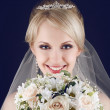 Portrait of a gorgeous blonde bride with splendid shiny smile ho — Stock Photo #22855188