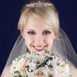 Portrait of a gorgeous blonde bride with splendid shiny smile ho — Stock Photo