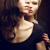 Emotive portrait of a beautiful fashion red-haired model and a h — Stock Photo