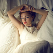 Vintage portrait of a glamorous ginger queen-like young woman si — Stock Photo